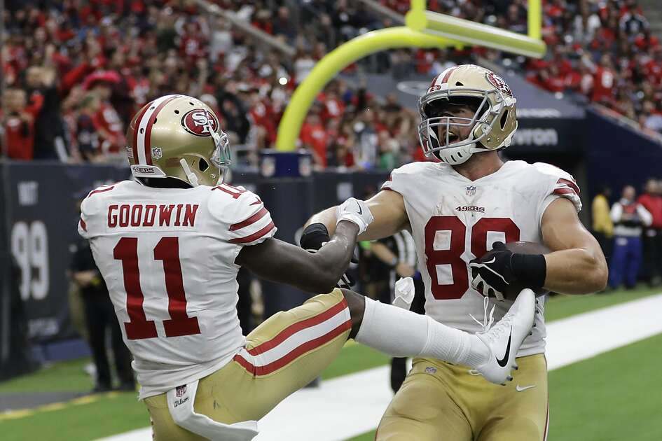 San Francisco 49ers tight end Garrett Celek (88) celebrates his touchdown catch with teammate Marquise Goodwin (11) during the second half of an NFL football game against the Houston Texans, Sunday, Dec. 10, 2017, in Houston. (AP Photo/David J. Phillip)