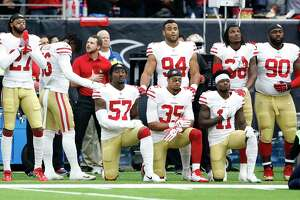 Several San Francisco 49ers players take a knee during the National Anthem before the start of the first quarter of an NFL football game at NRG Stadium, Sunday, Dec. 10, 2017, in Houston.