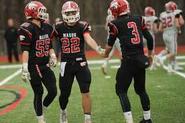 Masuk defeats New Canaan 28-14  in their Class L football semifinal game at Masuk High School in Monroe, Conn. on Sunday, December 3, 2017.