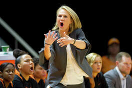 Texas Head Coach Karen Aston calls to her team in the first half of an NCAA college basketball game against Tennessee, Sunday, Dec. 10, 2017, in Knoxville, Tenn. (AP Photo/Calvin Mattheis)