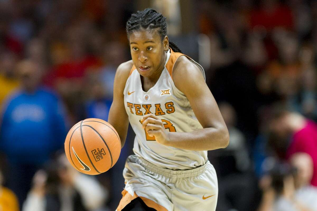 Texas guard Ariel Atkins (23) dribbles down the court in the first half of an NCAA college basketball game against Tennessee, Sunday, Dec. 10, 2017, in Knoxville, Tenn. (AP Photo/Calvin Mattheis)