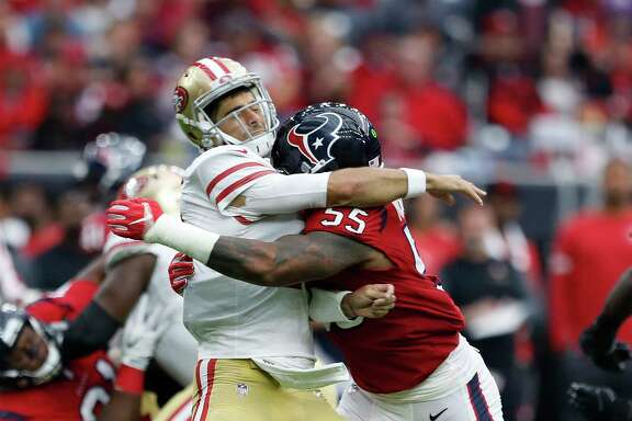 Houston Texans inside linebacker Benardrick McKinney (55) hits San Francisco 49ers quarterback Jimmy Garoppolo (10) after Garoppolo threw a pass during the third quarter of an NFL football game at NRG Stadium, Sunday, Dec. 10, 2017, in Houston.