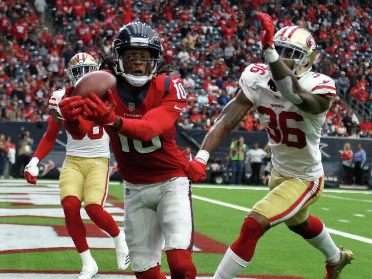 Houston Texans wide receiver DeAndre Hopkins (10) catches a pass in the end zone for a touchdown against San Francisco 49ers cornerback Dontae Johnson (36)during the third quarter of an NFL football game at NRG Stadium, Sunday, Dec. 10, 2017, in Houston.