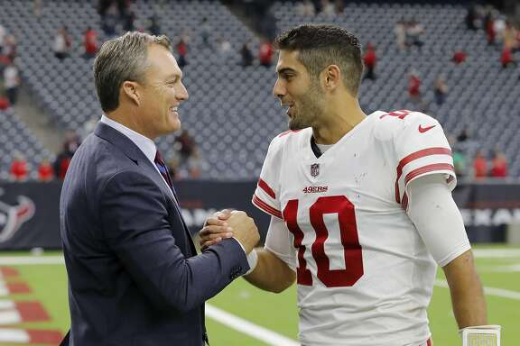 HOUSTON, TX - DECEMBER 10:  Jimmy Garoppolo #10 of the San Francisco 49ers celebrates with general manager John Lynch after the game against the Houston Texans at NRG Stadium on December 10, 2017 in Houston, Texas.  (Photo by Tim Warner/Getty Images)