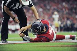 Houston Texans quarterback Tom Savage (3) is checked by a referee after he was hit during the first half of an NFL football game against the San Francisco 49ers, Sunday, Dec. 10, 2017, in Houston. Savage left the game. (AP Photo/Eric Christian Smith)