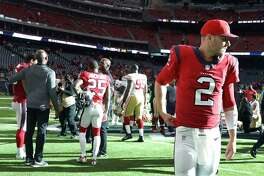 Houston Texans quarterback T.J. Yates (2) walks off the field after the Texans lost to San Francisco 49ers after an NFL football game at NRG Stadium, Sunday, Dec. 10, 2017, in Houston.