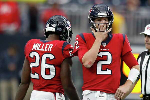 Houston Texans quarterback T.J. Yates (2) wipes his face during the fourth quarter of an NFL football game at NRG Stadium, Sunday, Dec. 10, 2017, in Houston.