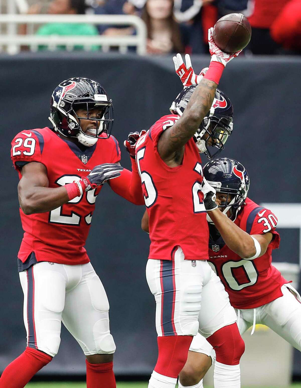 Houston Texans defensive backs Kareem Jackson (25), Andre Hal (29) and Kevin Johnson (30) celebrate Jackson's interception of a pass by San Francisco 49ers quarterback Jimmy Garoppolo during the first quarter of an NFL football game at NRG Stadium on Sunday, Dec. 10, 2017, in Houston.