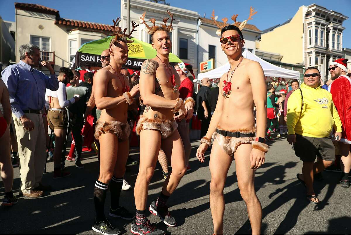 (left to right) Damian Beard, Chris Hanner and Chris Tipton-King came dressed as reindeer to the Santa Skivvies Run in the Castro District in San Francisco, Calif., on Sunday, December 10, 2017.