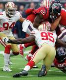 Houston Texans running back Lamar Miller (26) is hit by San Francisco 49ers defensive end Tank Carradine (95) during the third quarter of an NFL football game at NRG Stadium on Sunday, Dec. 10, 2017, in Houston.