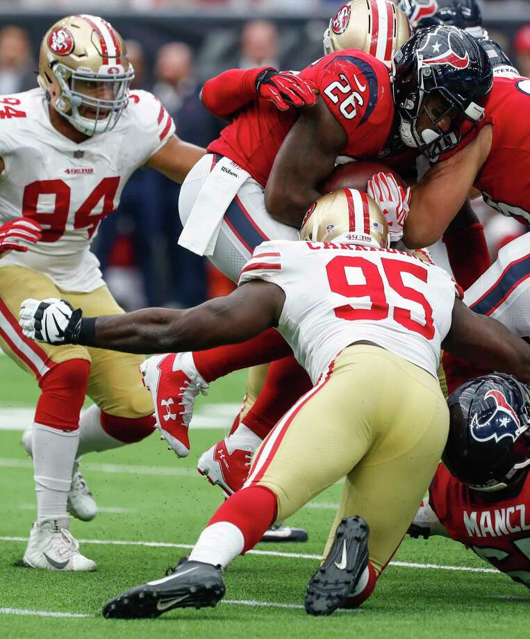 Houston Texans running back Lamar Miller (26) is hit by San Francisco 49ers defensive end Tank Carradine (95) during the third quarter of an NFL football game at NRG Stadium on Sunday, Dec. 10, 2017, in Houston. Photo: Brett Coomer, Houston Chronicle / © 2017 Houston Chronicle