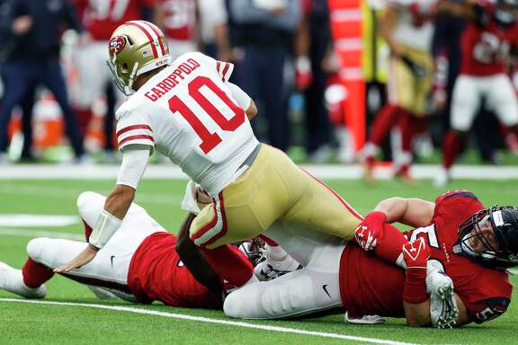 San Francisco 49ers quarterback Jimmy Garoppolo (10) is sacked by Houston Texans inside linebacker Brian Cushing (56) and inside linebacker Zach Cunningham during the fourth quarter of an NFL football game at NRG Stadium on Sunday, Dec. 10, 2017, in Houston.