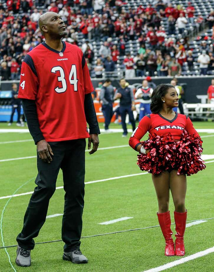 Former Houston Rockets great Hakeem Olajuwon and Olympic gold medalist Simone Biles, who was an honorary Houston Texans cheerleader, stood on the field before an NFL football game between the Houston Texans and the San Francisco 49ers at NRG Stadium on Sunday, Dec. 10, 2017, in Houston. Photo: Brett Coomer, Houston Chronicle / © 2017 Houston Chronicle