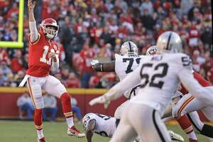 Kansas City Chiefs quarterback Alex Smith (11) throws during the second half of an NFL football game against the Oakland Raiders in Kansas City, Mo., Sunday, Dec. 10, 2017. (AP Photo/Charlie Riedel)
