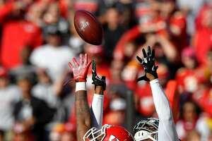 Kansas City Chiefs defensive back Darrelle Revis breaks up a pass intended for Oakland Raiders wide receiver Amari Cooper in the second quarter on Sunday, Dec. 10, 2017 at Arrowhead Stadium in Kansas City, Mo. (John Sleezer/Kansas City Star/TNS)
