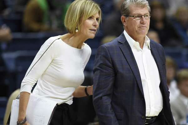 Associate head coach Chris Dailey, left, talks to Connecticut head coach Geno Auriemma in the second half of an NCAA college exhibition basketball game, Sunday, Nov. 5, 2017, in Storrs, Conn. (AP Photo/Jessica Hill)in the second half of an NCAA college exhibition basketball game, Sunday, Nov. 5, 2017, in Storrs, Conn. (AP Photo/Jessica Hill)