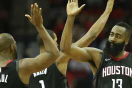 Houston Rockets guard James Harden (13) high-fives guard Chris Paul during the second half of an NBA basketball game against the Indiana Pacers, Wednesday, Nov. 29, 2017, in Houston. Houston won the game 118-97. (AP Photo/Eric Christian Smith)