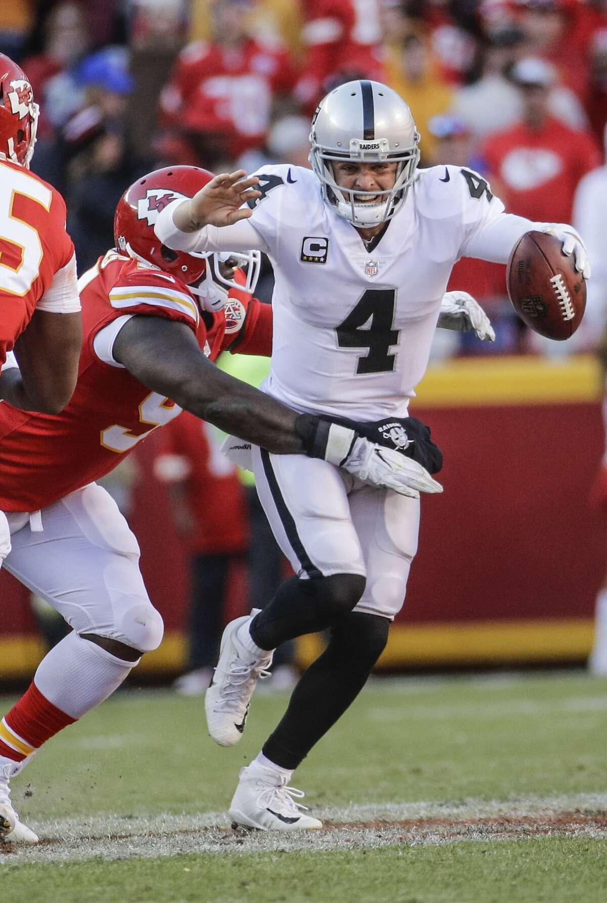 Kansas City Chiefs defensive lineman Rakeem Nunez-Roches (99) sacks Oakland Raiders quarterback Derek Carr (4) during the second half of an NFL football game in Kansas City, Mo., Sunday, Dec. 10, 2017. (AP Photo/Charlie Riedel)