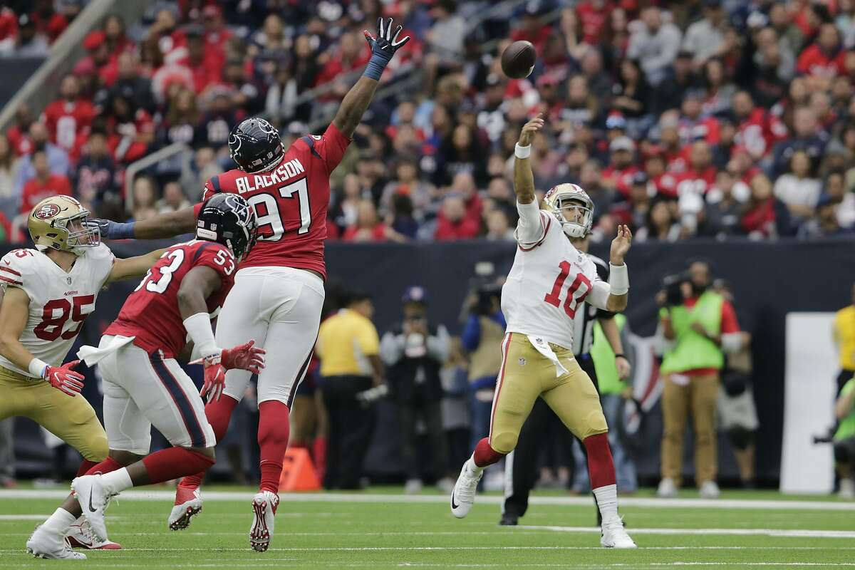 HOUSTON, TX - DECEMBER 10: Jimmy Garoppolo #10 of the San Francisco 49ers throws a pass in the second half defended by Angelo Blackson at NRG Stadium on December 10, 2017 in Houston, Texas. (Photo by Tim Warner/Getty Images)