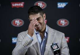 San Francisco 49ers quarterback Jimmy Garoppolo talks with the media following an NFL football game against the Houston Texans, Sunday, Dec. 10, 2017, in Houston. (AP Photo/David J. Phillip)