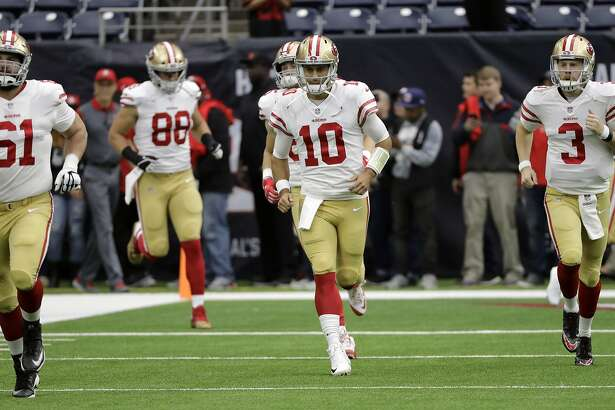 San Francisco 49ers quarterback Jimmy Garoppolo (10) runs on to the field with teammates before an NFL football game against the Houston Texans, Sunday, Dec. 10, 2017, in Houston. (AP Photo/David J. Phillip)