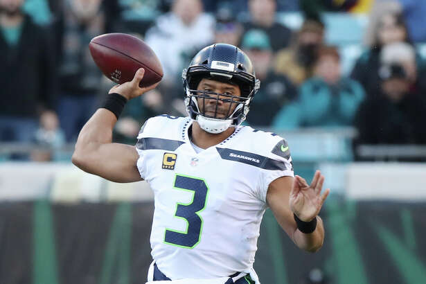 JACKSONVILLE, FL - DECEMBER 10:  Russell Wilson #3 of the Seattle Seahawks looks to pass the football during the first half of their game against the Jacksonville Jaguars at EverBank Field on December 10, 2017 in Jacksonville, Florida.  (Photo by Logan Bowles/Getty Images)