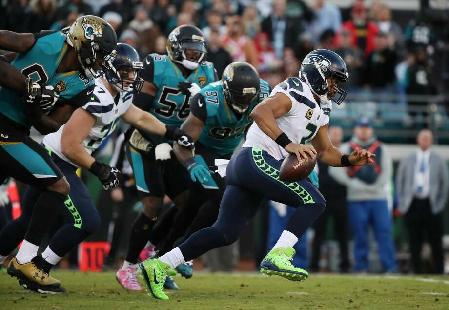 JACKSONVILLE, FL - DECEMBER 10:  Russell Wilson #3 of the Seattle Seahawks runs with the football during the first half of their game against the Jacksonville Jaguars at EverBank Field on December 10, 2017 in Jacksonville, Florida.  (Photo by Logan Bowles/Getty Images) Photo: Logan Bowles/Getty Images