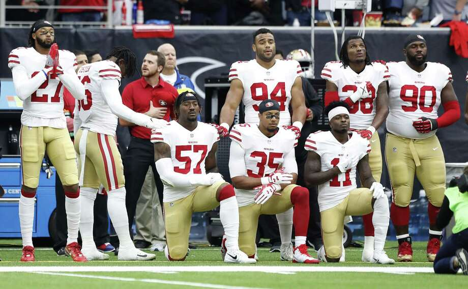 Several San Francisco 49ers players take a knee during the National Anthem before the start of the first quarter of an NFL football game at NRG Stadium, Sunday, Dec. 10, 2017, in Houston. Photo: Karen Warren / Houston Chronicle / © 2017 Houston Chronicle