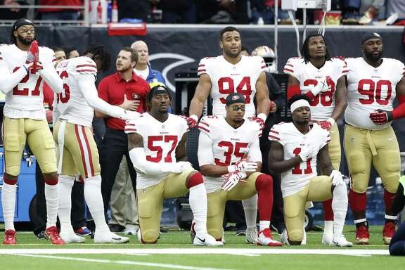 Several San Francisco 49ers players take a knee during the National Anthem before the start of the first quarter of an NFL football game at NRG Stadium, Sunday, Dec. 10, 2017, in Houston.  ( Karen Warren / Houston Chronicle )