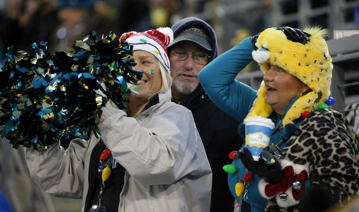 Jacksonville Jaguars fans cheer during the first half of an NFL football game against the Seattle Seahawks, Sunday, Dec. 10, 2017, in Jacksonville, Fla. (AP Photo/Stephen B. Morton)