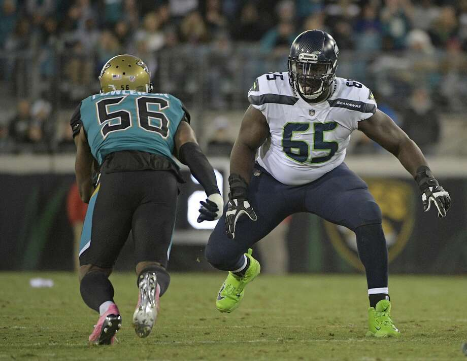 Seattle Seahawks offensive tackle Germain Ifedi (65) looks to block Jacksonville Jaguars defensive end Dante Fowler Jr., (56) during the first half of an NFL football game, Sunday, Dec. 10, 2017, in Jacksonville, Fla. (AP Photo/Phelan M. Ebenhack) Photo: Phelan M. Ebenhack/AP