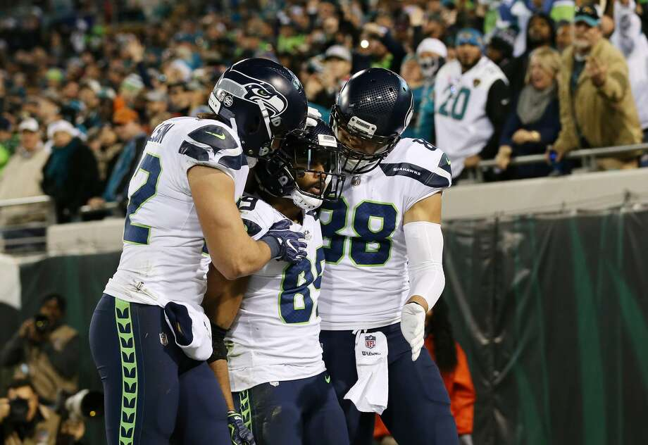 JACKSONVILLE, FL - DECEMBER 10:   Doug Baldwin #89 of the Seattle Seahawks celebrates with his teammates after a 26-yard touchdown during the second half of their game against the Jacksonville Jaguars at EverBank Field on December 10, 2017 in Jacksonville, Florida.  (Photo by Logan Bowles/Getty Images) Photo: Logan Bowles/Getty Images