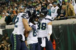 JACKSONVILLE, FL - DECEMBER 10:   Doug Baldwin #89 of the Seattle Seahawks celebrates with his teammates after a 26-yard touchdown during the second half of their game against the Jacksonville Jaguars at EverBank Field on December 10, 2017 in Jacksonville, Florida.  (Photo by Logan Bowles/Getty Images)