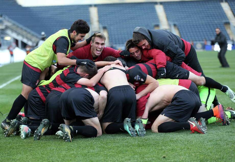 Stanford celebrates after winning Sunday's NCAA College Cup championship game against Indiana in Chester, PA on Sunday December 10, 2017. Photo: Tony Quinn / Tony Quinn