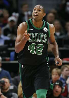 Boston Celtics forward Al Horford (42) talks to a teammate while heading up court against the Detroit Pistons during the second half of an NBA basketball game Sunday, Dec. 10, 2017, in Detroit. (AP Photo/Duane Burleson)