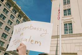 A protestor lifts his sign during a rally on Sunday December 10, 2017 at the Hipolito F. Garcia Federal Building and Courthouse in San Antonio, TX where people gathered to protest President Trump's plan to move the U.S. Embassy from Tel Aviv to Jerusalem.