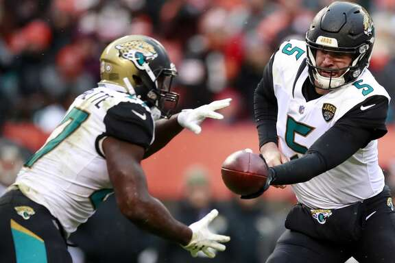 Jacksonville Jaguars quarterback Blake Bortles (5) hands the ball off to Jacksonville Jaguars running back Leonard Fournette (27) against the Cleveland Browns during an NFL football game, Sunday, Nov. 19, 2017, in Cleveland. (Jeff Haynes/AP Images for Panini)