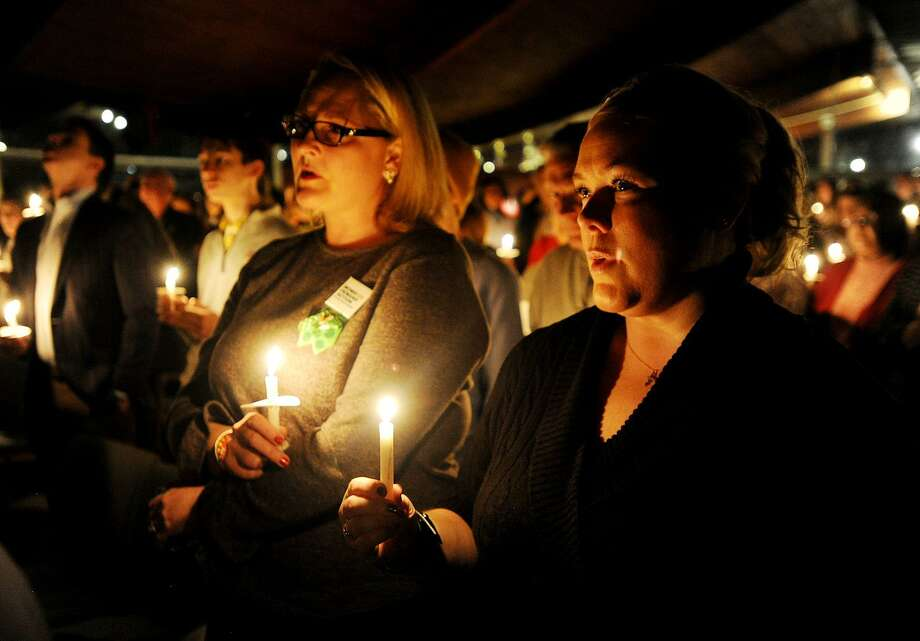 Kara Baekey, left, of Norwalk, and Amanda McCorry, of Wilton, of the group Moms Demand Action, participate in the Vigil to #End Gun Violence in Westport on Sunday. Photo: Brian A. Pounds / Hearst Connecticut Media / Connecticut Post