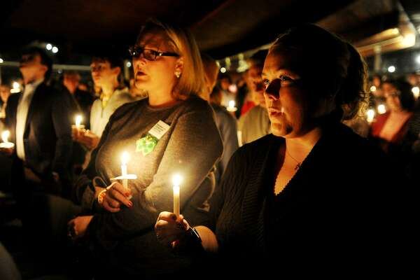 Kara Baekey, left, of Norwalk, and Amanda McCorry, of Wilton, of the group Moms Demand Action, participate in the Vigil to #End Gun Violence in Westport on Sunday.