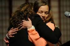 Gun violence survivors Abbey Clements, left, of Newtown, and Yvonne Crasso, of Middletown, hug after sharing their stories during the Vigil to #End Gun Violence at the Unitarian Church of Westport in Westport, Conn. on Sunday, December 10, 2017. Clements was a second grade teacher at Sandy Hook Elementary School during the mass killing five years ago.