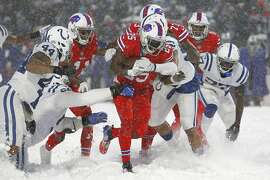 Buffalo Bills running back LeSean McCoy, center, runs the ball during overtime in an NFL football game against the Indianapolis Colts, Sunday, Dec. 10, 2017, in Orchard Park, N.Y. (AP Photo/Jeffrey T. Barnes)