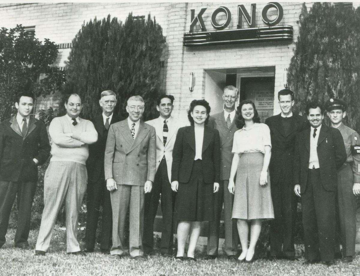 In this early KONO radio shot, founder Eugene Roth (fourth from left) poses with his staff outside his station. In 1927, he reportedly started broadcasting as a hobby in a room above his mechanics garage.