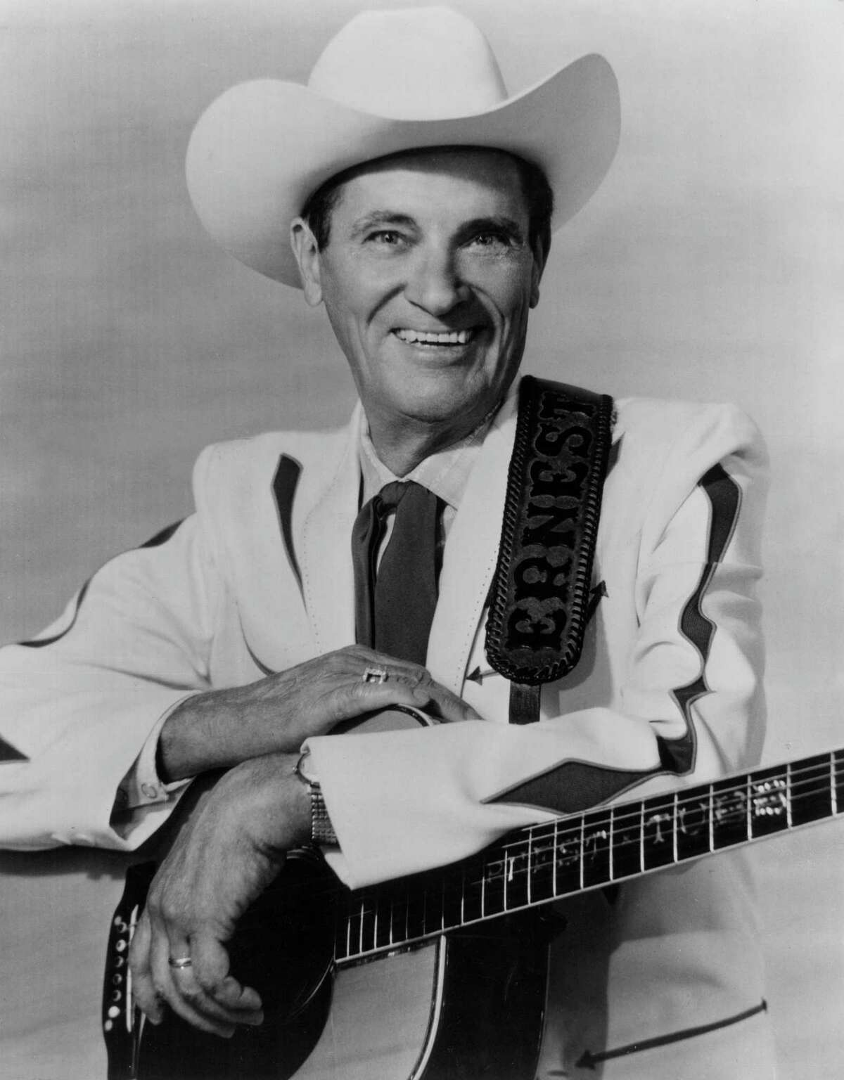 Famed country singer Ernest Tubb rode his bicycle, guitar strapped to his back, to KONO studios back in the late 1930s to perform songs live each morning on the radio station during its early years. The Texas-born star is seen here in 1978.