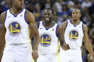 It could be argued that Golden State's Draymond Green (center) is the most important player on a Warriors team loaded with All-Stars in their prime.