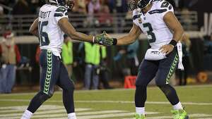 Seattle Seahawks quarterback Russell Wilson (3) shakes hands with wide receiver Tyler Lockett after he caught a 74-yard touchdown pass during the second half of an NFL football game against the Jacksonville Jaguars, Sunday, Dec. 10, 2017, in Jacksonville, Fla. (AP Photo/Phelan M. Ebenhack)