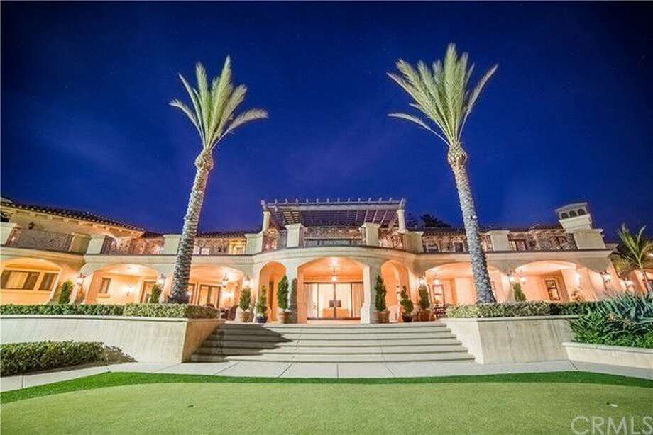 The estate of Lynsi Snyder, the billionaire president of In-N-Out Burger, at 340 Old Ranch Road, Bradbury, California, is listed at $19,799,000. The Mediterranean-style home was built in 2010 and features a 2,500-square-foot guest house and a fully equipped indoor batting cage. Photo: Realtor.com