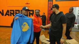 The Warriors'Stephen Curry donated gear and shot some baskets with the basketball team at McClymonds High School in Oakland.