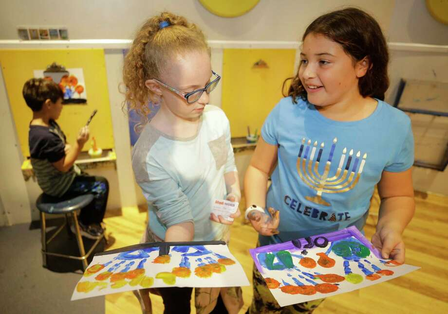 Lyssa Vick, 10, left, and Orina Cohen, 10, compare their finished art work during a Hanukkah activities event lead by the Jewish Community Center at the Children's Museum of Houston. Photo: Melissa Phillip, Houston Chronicle / © 2017 Houston Chronicle