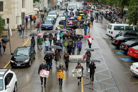 University of Texas at Austin graduate students protest low wages and proposed federal legislation that would tax tuition exemptions as income during a graduate student walkout at the school last week.
