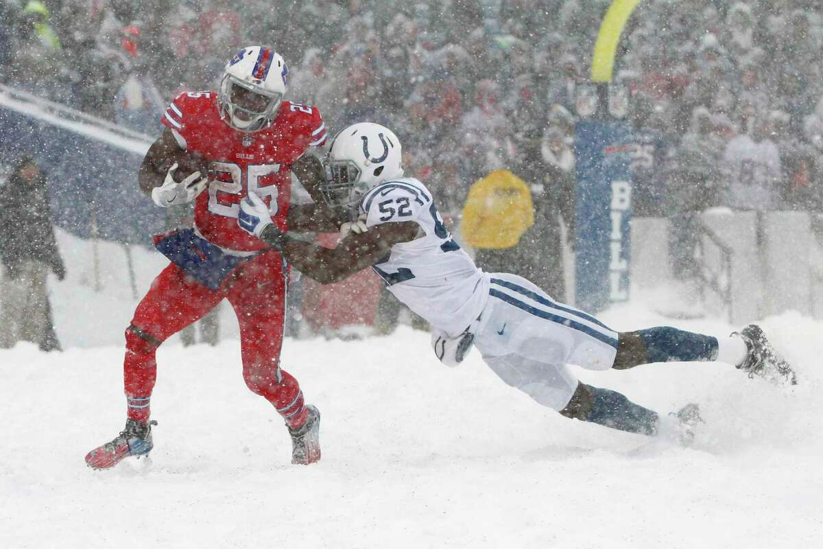 Indianapolis Colts outside linebacker Barkevious Mingo, right, tries to tackle Buffalo Bills running back LeSean McCoy during the second half of an NFL football game, Sunday, Dec. 10, 2017, in Orchard Park, N.Y. (AP Photo/Jeffrey T. Barnes) ORG XMIT: NYSW117